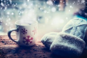 Warm coffee and winter gloves